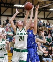 Laconia's Maci Grade battles for a rebound with St. Mary's Springs' Maddie Gehring on Tuesday during their game in Rosendale. Laconia won the game 57-45.