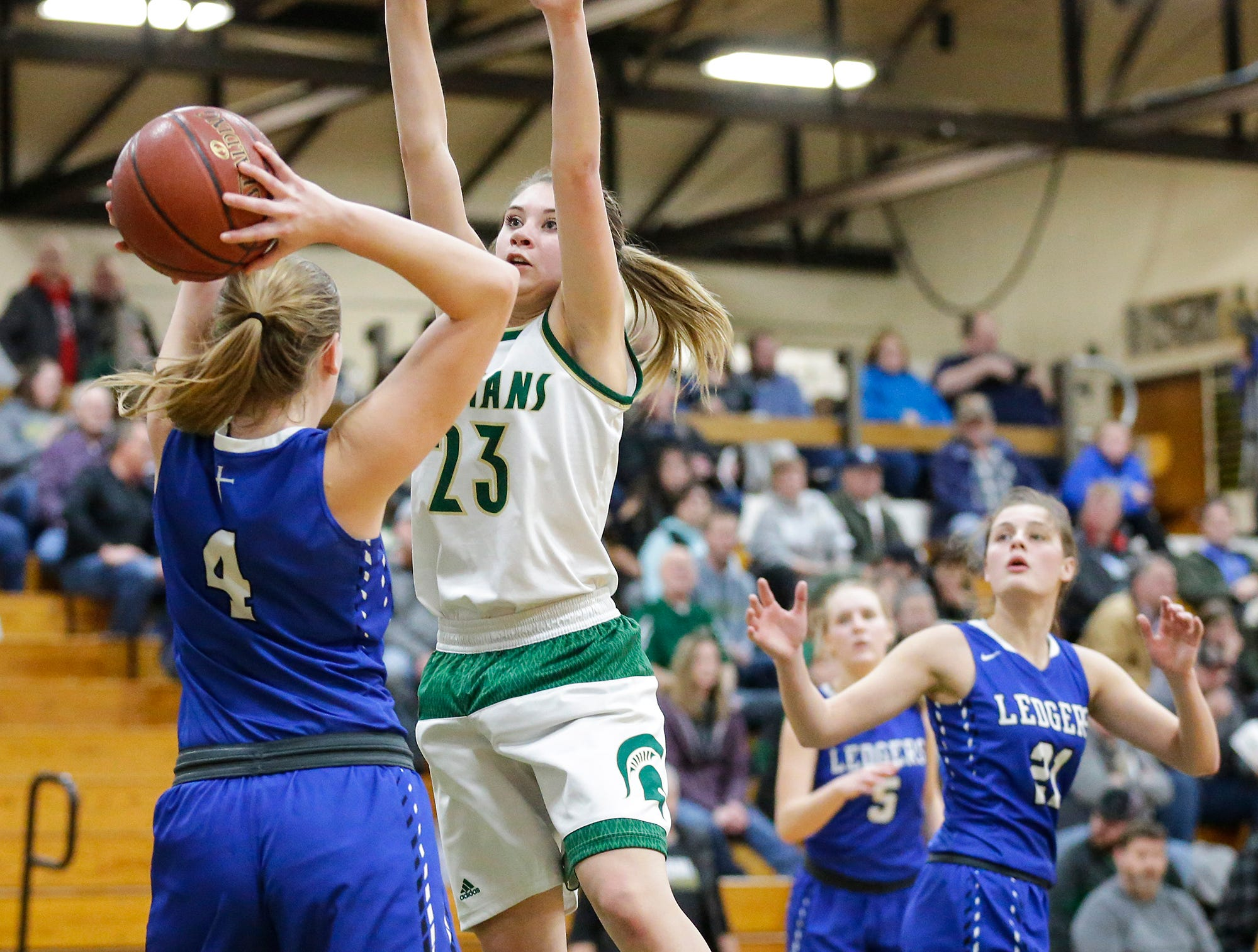 Laconia High School girls basketball's Harper Wurtz attempts to block a pass from St. Mary's Springs Academy's Brianna Freund Tuesday, January 15, 2019 during their game in Rosendale. Laconia won the game 57-45. Doug Raflik/USA TODAY NETWORK-Wisconsin