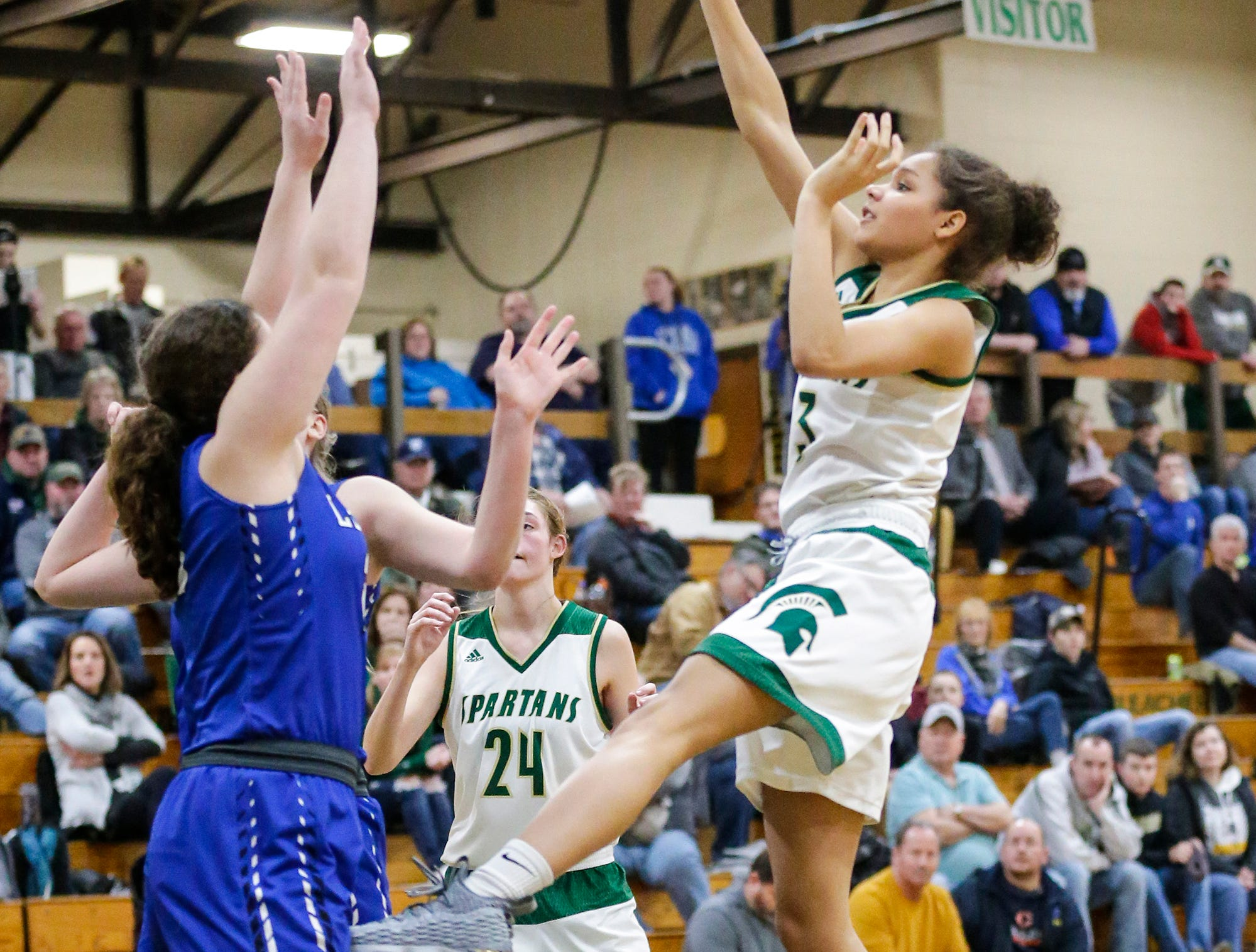 Laconia High School girls basketball's Kiarra Otto attempts a shot against St. Mary's Springs Academy Tuesday, January 15, 2019 during their game in Rosendale. Laconia won the game 57-45.