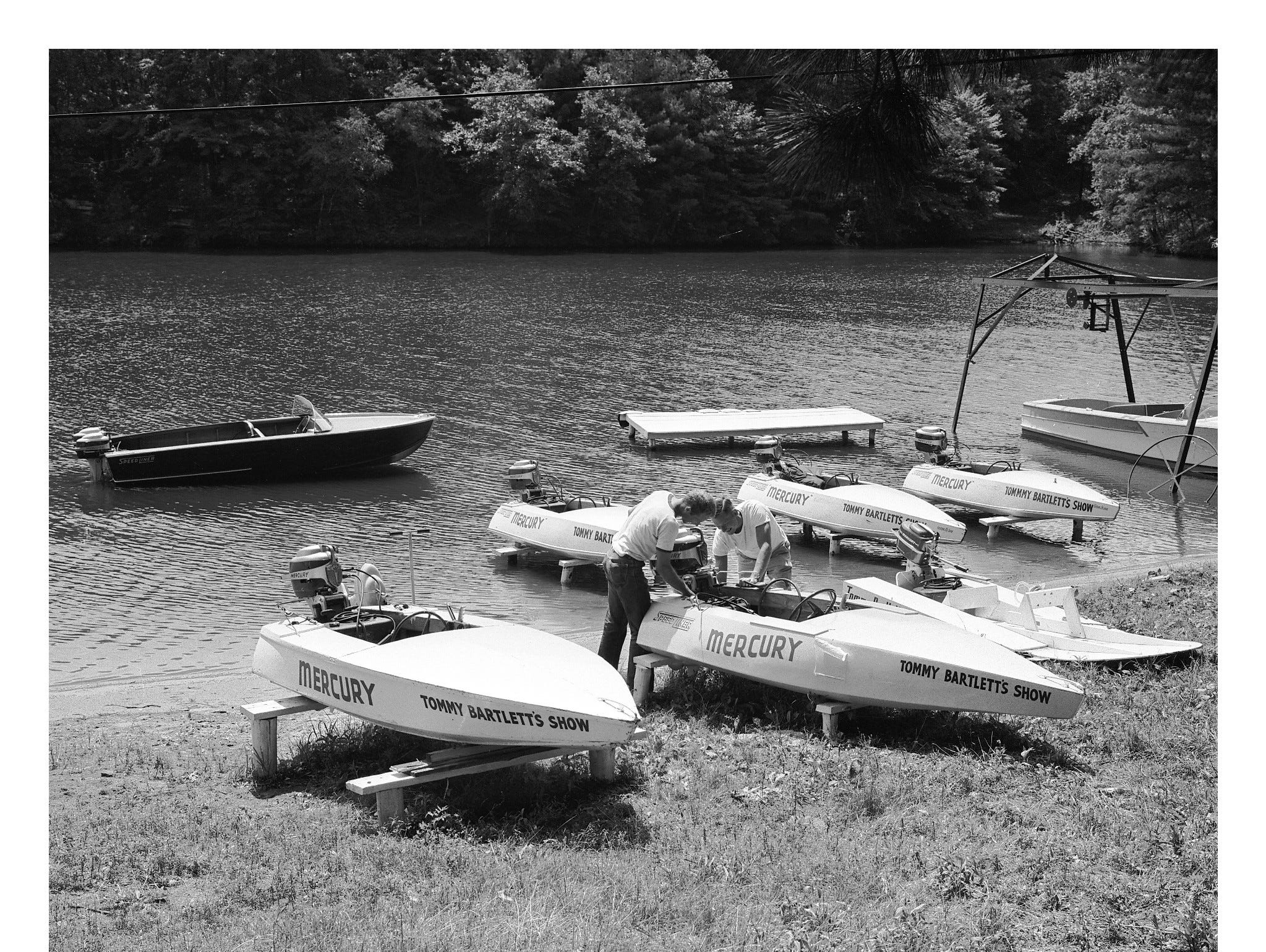 A fleet of boats powered by Mercury Marine engine's at the Tommy Bartlett show in 1956.
