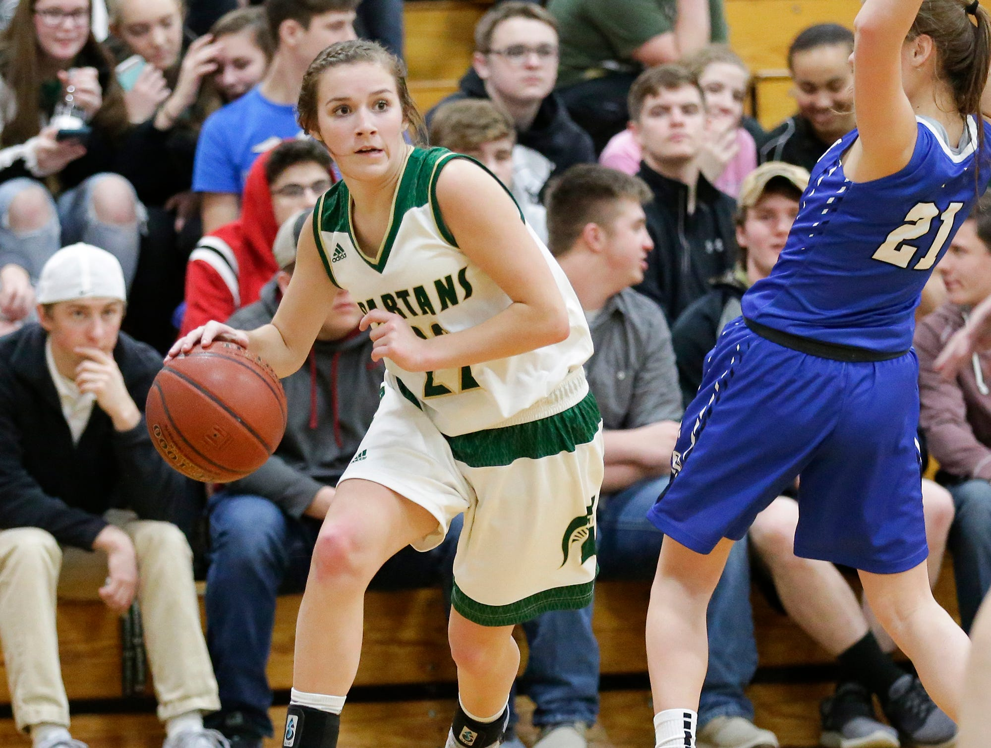 Laconia High School girls basketball's Haley Rens passes by St. Mary's Springs Academy's Jennifer Chatterton Tuesday, January 15, 2019 during their game in Rosendale. Laconia won the game 57-45. Doug Raflik/USA TODAY NETWORK-Wisconsin