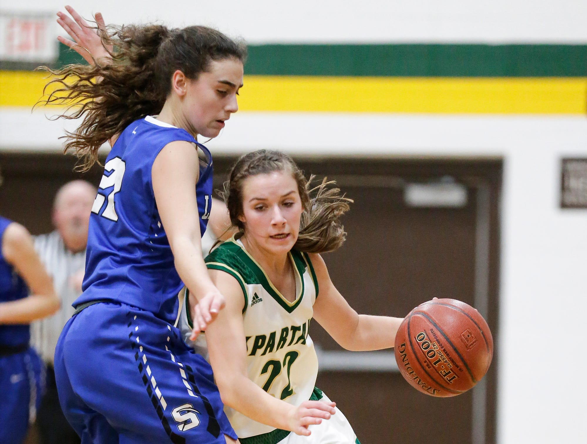 Laconia High School girls basketball's Haley Rens makes her way past St. Mary's Springs Academy's Isabelle Coon Tuesday, January 15, 2019 during their game in Rosendale. Laconia won the game 57-45. Doug Raflik/USA TODAY NETWORK-Wisconsin