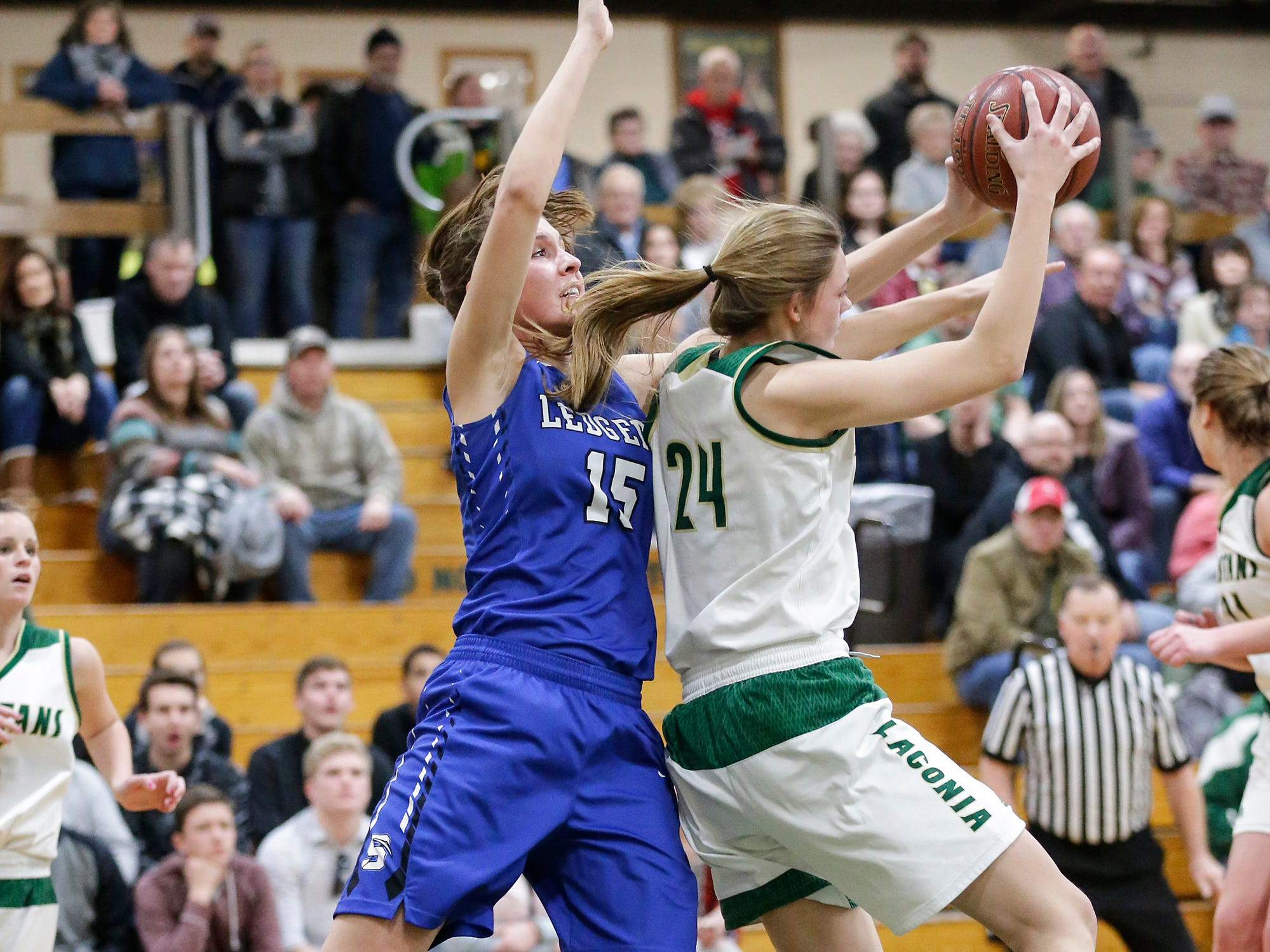 Laconia High School girls basketball's Maci Grade steals a pass intended for St. Mary's Springs Academy's Maddie Gehring Tuesday, January 15, 2019 during their game in Rosendale. Laconia won the game 57-45. Doug Raflik/USA TODAY NETWORK-Wisconsin