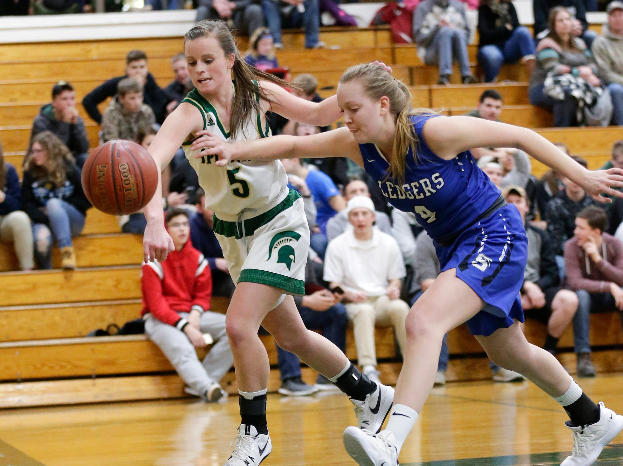 Laconia High School girls basketball's Jen Beattie and St. Mary's Springs Academy's Brianna Freund attempt to get a ball before it goes out of bounds Tuesday, January 15, 2019 during their game in Rosendale. Laconia won the game 57-45. Doug Raflik/USA TODAY NETWORK-Wisconsin