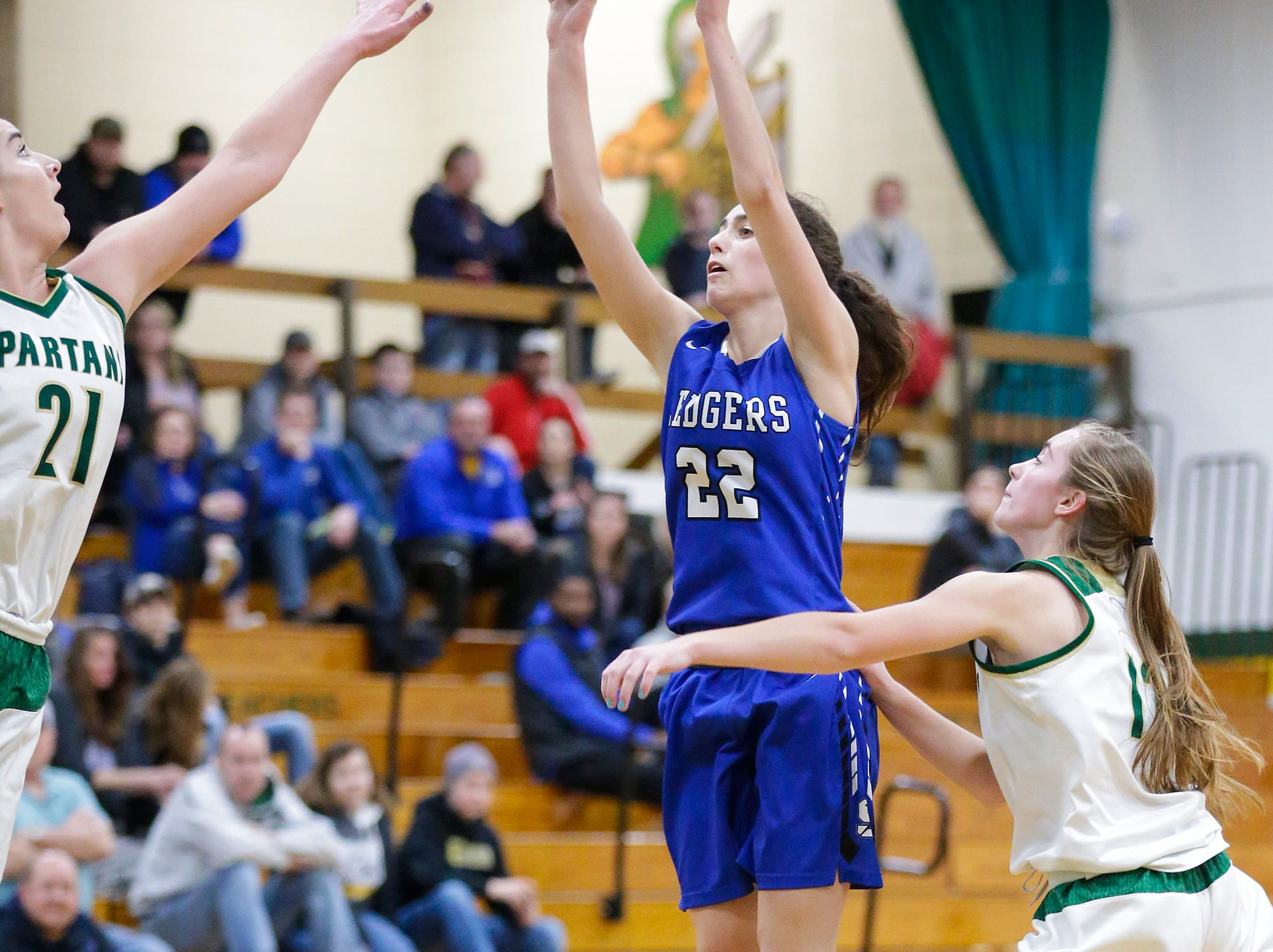 St. Mary's Springs Academy girls basketball's Isabelle Coon shoots a basket against Laconia High School's Alissa Dins (21) and Lexy Smit (12) Tuesday, January 15, 2019 during their game in Rosendale. Laconia won the game 57-45. Doug Raflik/USA TODAY NETWORK-Wisconsin