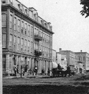Built by Oscar Ball in 1874, the fine old Second Empire style hotel is seen here on the northwest corner of Front and Birchard.