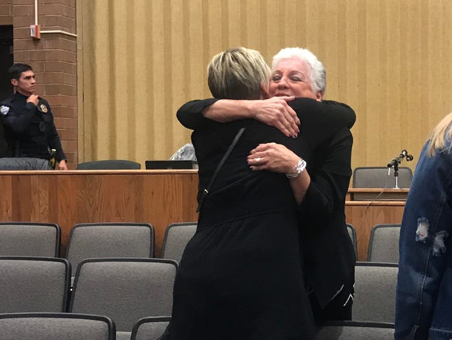 Poudre School District board member Susan Gutowsky hugs a supporter after being selected for Fort Collins City Council.