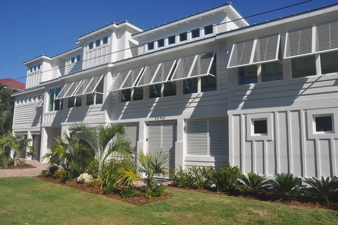 This home on Sanibel stretches along San Carlos Bay.