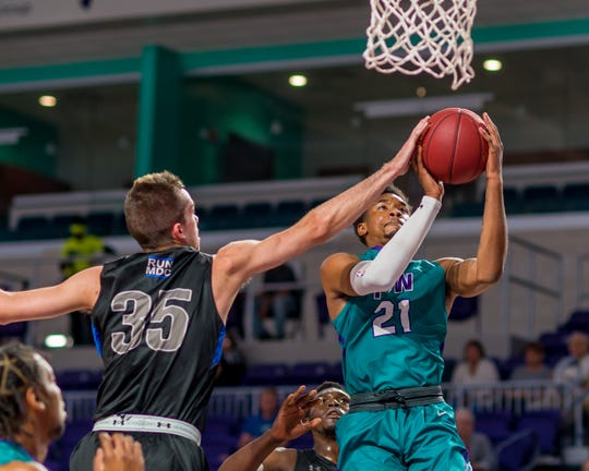 FSW's Charles Manning Jr. goes to the net against Miami Dade College  on Nov. 27, 2018.
