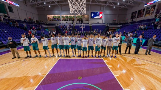 The FSW men's basketball team stands at attention before a game against Miami Dade College  on Nov. 27, 2018 at Suncoast Arena.