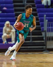FSW's Charles Manning Jr. brings the ball up the court against Miami Dade College  on Nov. 27, 2018.
