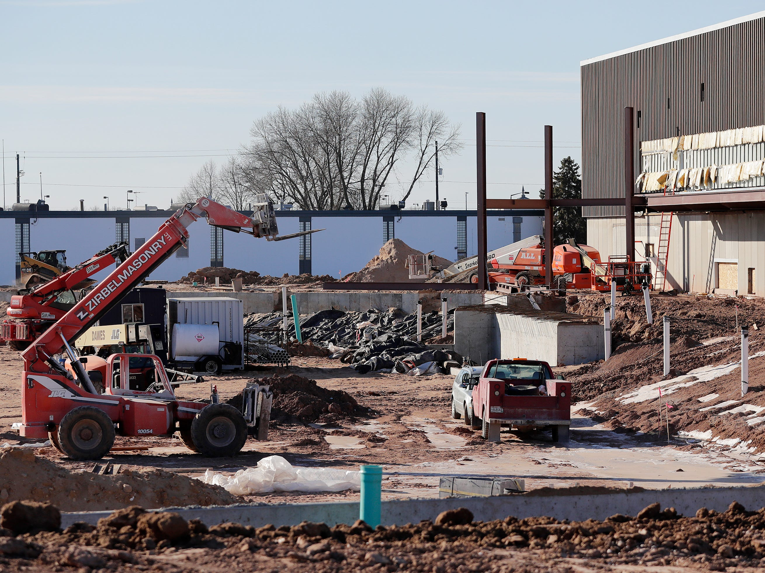 Construction for Capital Credit Union Park is ongoing, viewed from beyond the left field wall, on Wednesday, January 16, 2019 in Ashwaubenon, Wis. The stadium is set to open this spring and will host the Green Bay Booyah baseball team in the Northwoods League and a United Soccer Leagues League 2 team.