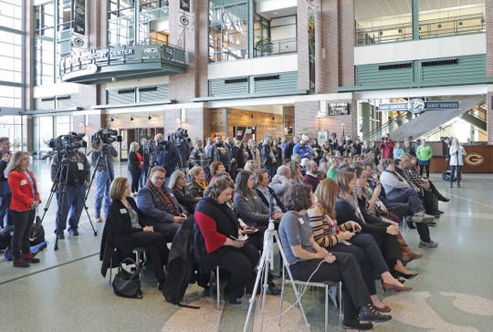 Representatives of Green Bay area nonprofit organizations listen as Green Bay Packers president Mark Murphy speaks during the launch of Give Big Green Bay in the Atrium at Lambeau Field on Wednesday.