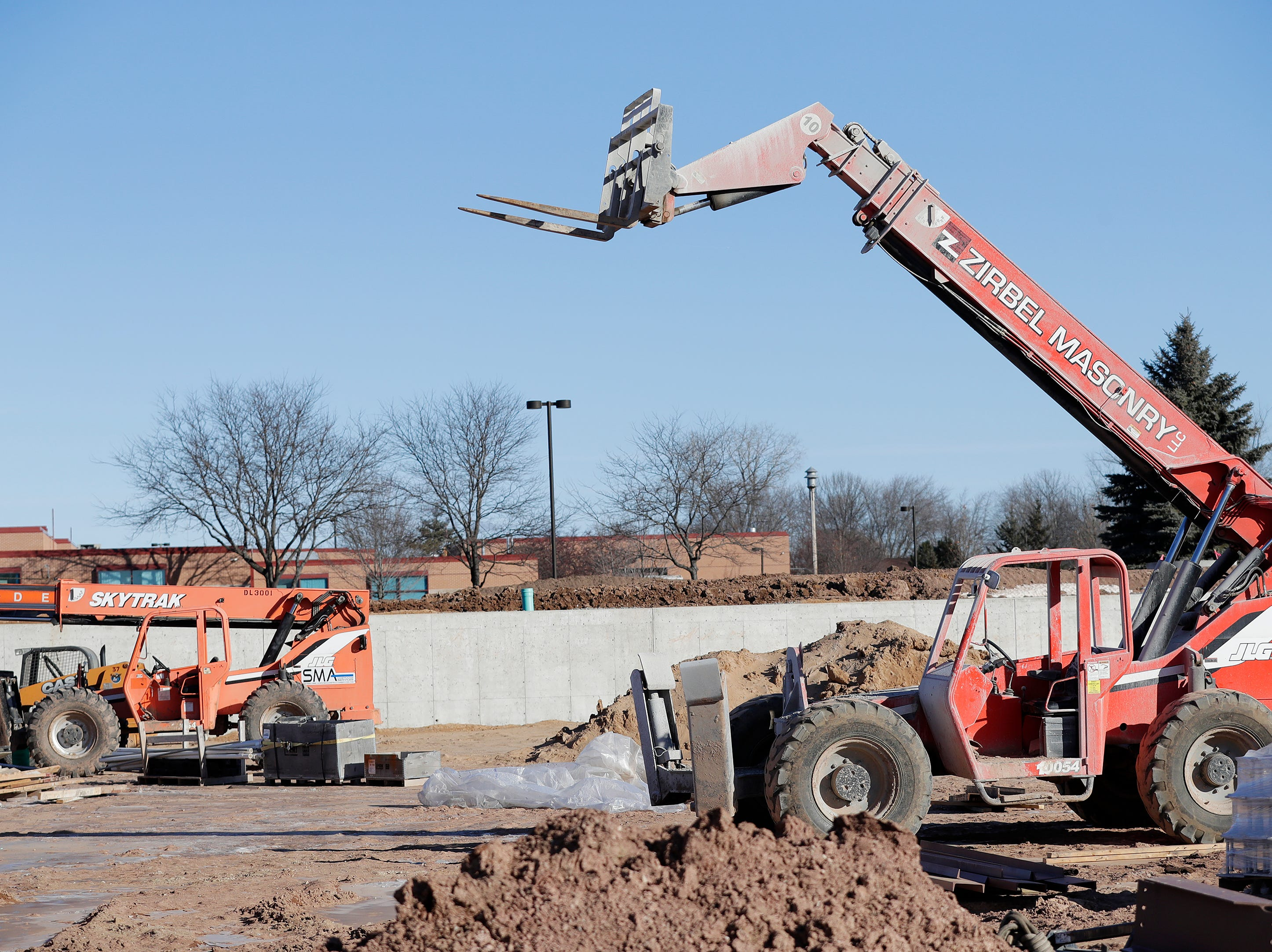 Construction equipment is parked in left field of Capital Credit Union Park on Wednesday, January 16, 2019 in Ashwaubenon, Wis. The stadium is set to open this spring and will host the Green Bay Booyah baseball team in the Northwoods League and a United Soccer Leagues League 2 team.