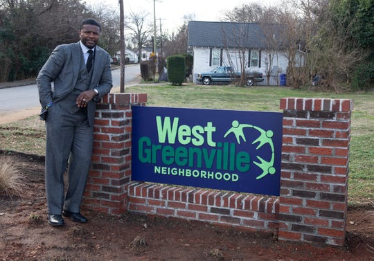 Shammond Williams in front of the West Greenville Neighborhood sign on Tues. Jan. 15, 2019.