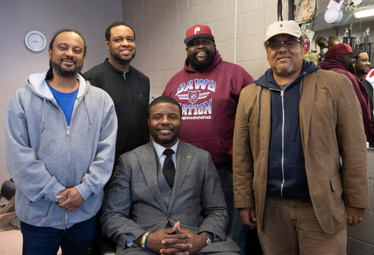 Shammond Williams (center) at his hometown barber shop, District 25 Barber Shop, surrounded by Philippe Henry (from left), Rick Robertson, Jonathan Campbell, and Terry Carter on Tues. Jan. 15, 2019.