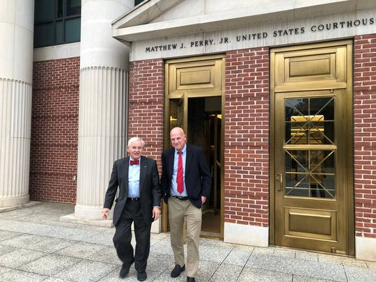 Voting machine plaintiffs Phil Leventis (l) and Frank Heindel leave courthouse.