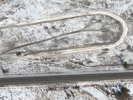 This aerial photo taken Wednesday shows how the skijoring track is progressing after hundreds of loads of snow were hauled in from town due to the lack of snow.