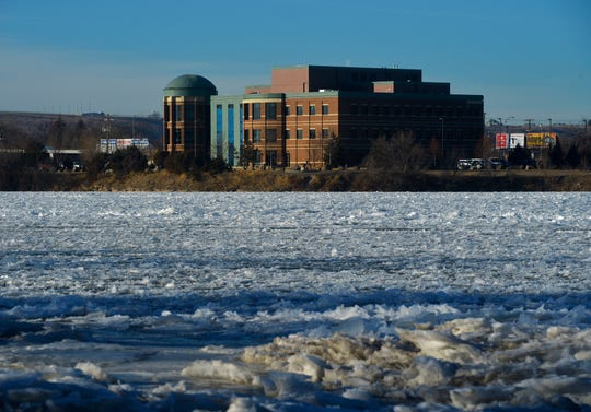 Ice builds up on the Missouri River across from the Missouri River Federal Courthouse, Wednesday.
