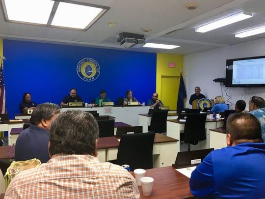 The Mayor's Council listens to a presentation by Guam Waterworks Authority Chief Engineer Thomas Cruz on Wednesday, Jan 6.