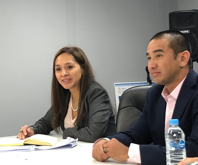 Department of Revenue and Taxation acting Director Dafne Shimizu and Attorney General Leevin Camacho meet on Jan. 16, 2019.