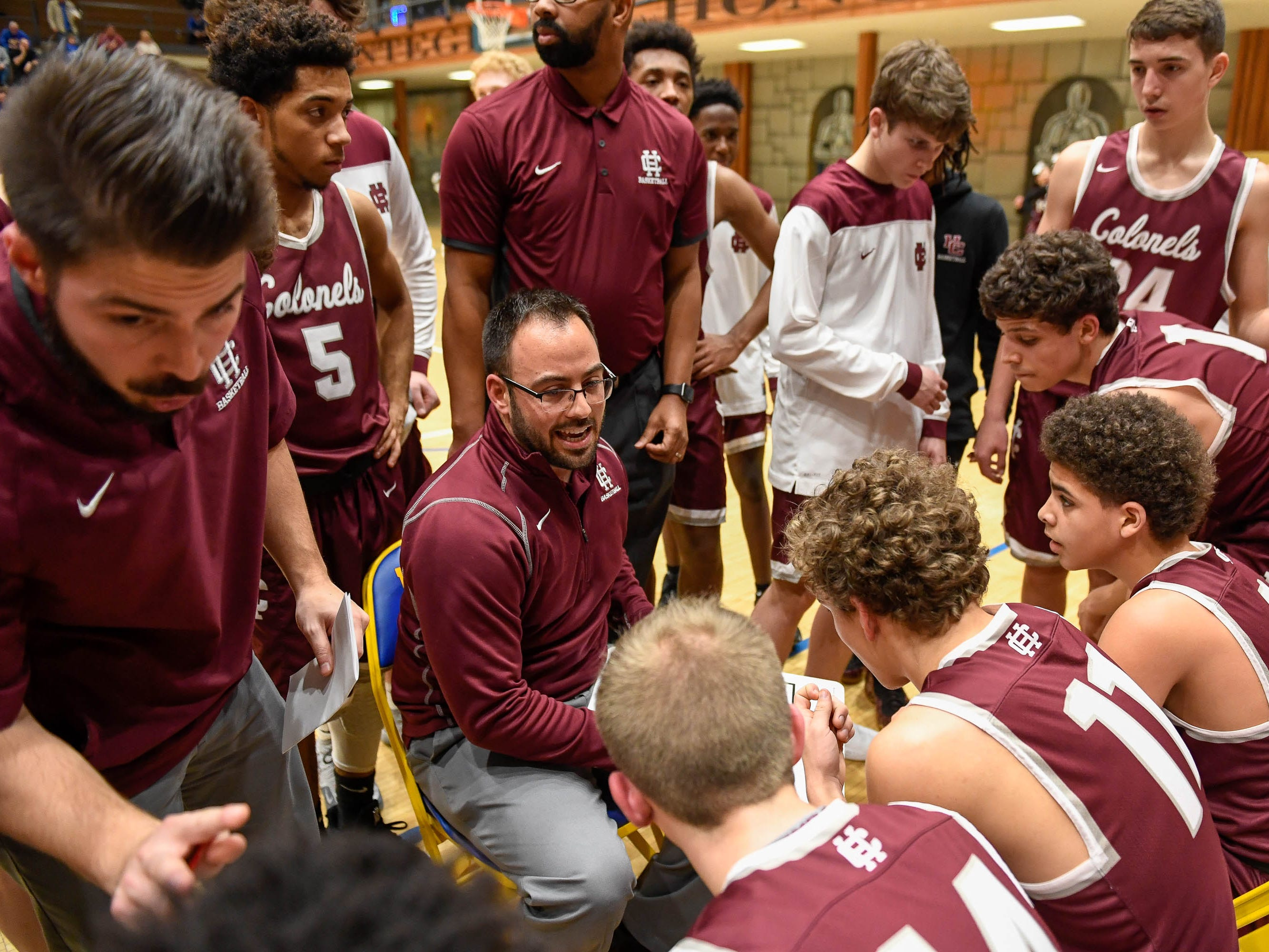 Henderson Head Coach Tyler Smithart talks to his team during a timeout as the Castle Knights play the Henderson County Colonels in Paradise Tuesday, January 15, 2019.