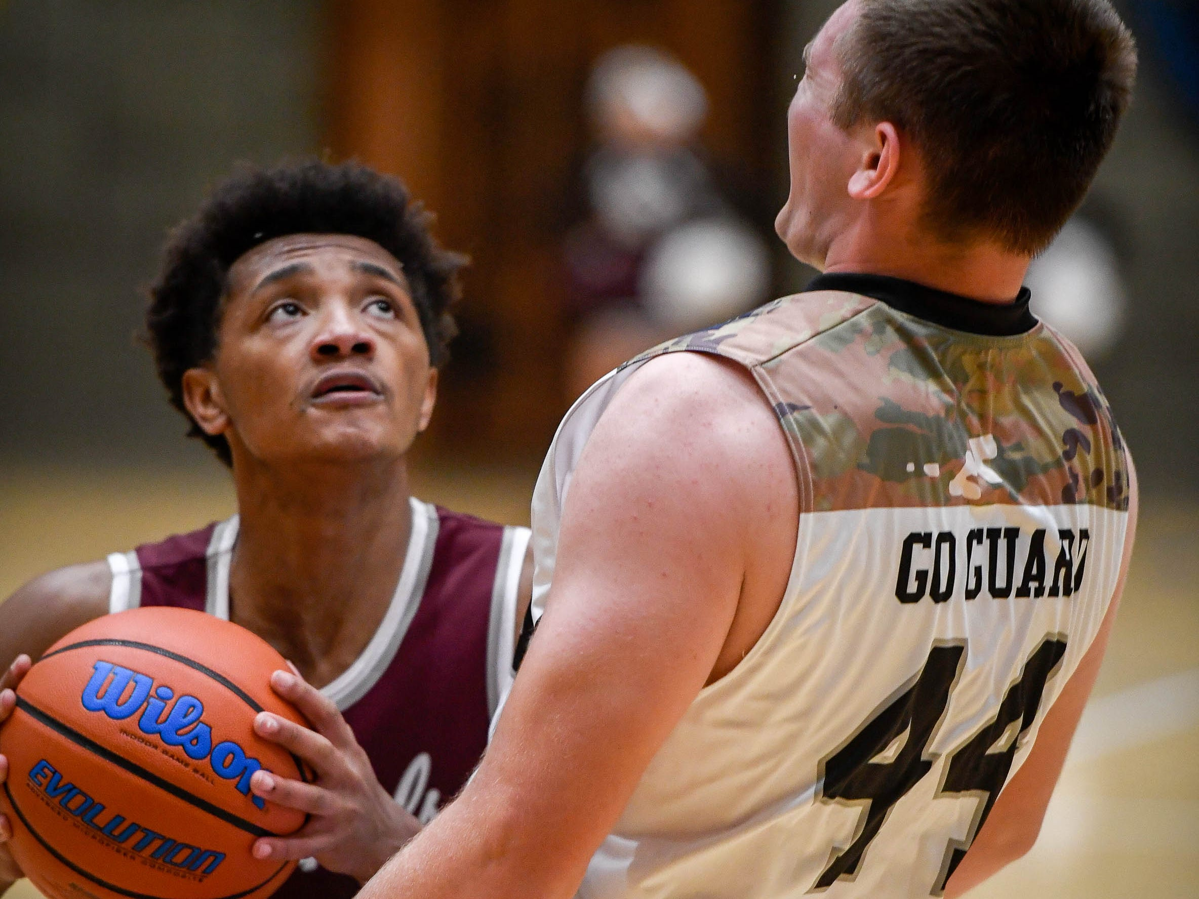 Castle's Brodey Heaton (44) tries to take a charge as Henderson's Daymian Dixon (3) looks to shoot as the Castle Knights play the Henderson County Colonels in Paradise Tuesday, January 15, 2019.