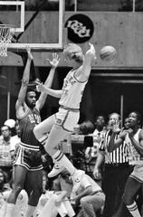 Indiana State's Larry Bird passes the ball backward to teammate Alex Gilbert March 24, 1979 in the NCAA semi-finals at Salt Lake City.