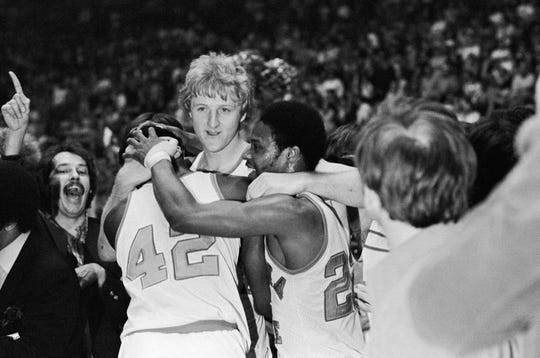 Indiana State star Larry Bird, center, embraces teammates Alex Gilbert, left, and Carl Nicks after the Sycamores beat Arkansas, 73-71, for the NCAA Midwest Regional crown in Cincinnati Saturday, March 17, 1979. (AP Photo)