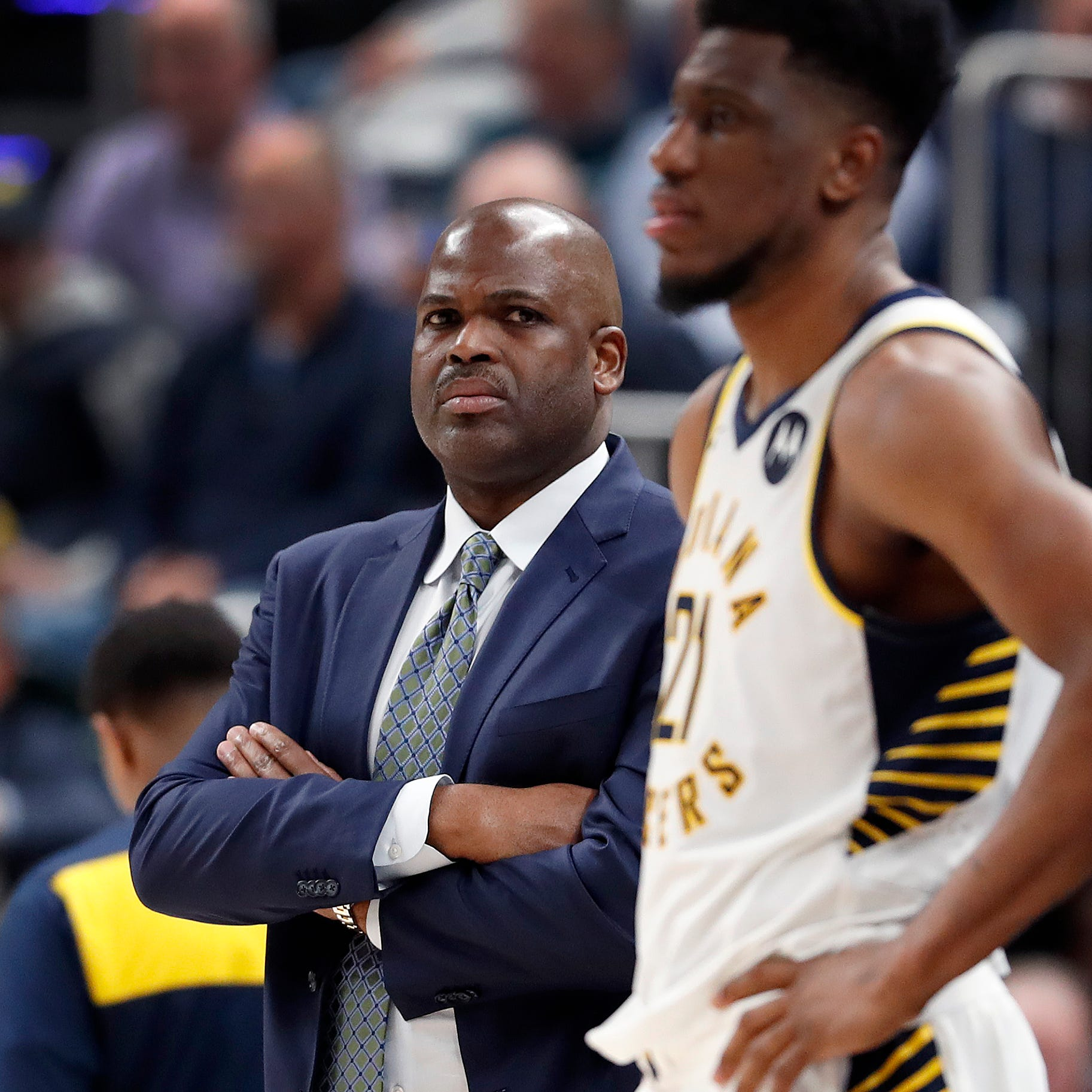 Indiana Pacers head coach Nate McMillan looks on...