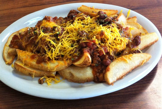 Chili smothers streak fries at Indy's Historic Steer Inn in Indianapolis.
