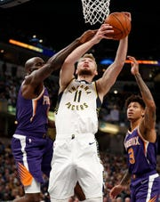 Indiana Pacers forward Domantas Sabonis (11) is fouled by Phoenix Suns Quincy Acy (4)  in the first half of their game at Bankers Life Fieldhouse on Tuesday, Jan. 15, 2019.