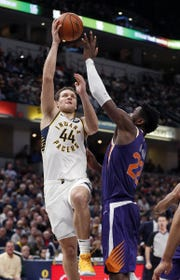 Indiana Pacers forward Bojan Bogdanovic (44) shoots over Phoenix Suns center Deandre Ayton (22) in the first half of their game at Bankers Life Fieldhouse on Tuesday, Jan. 15, 2019.