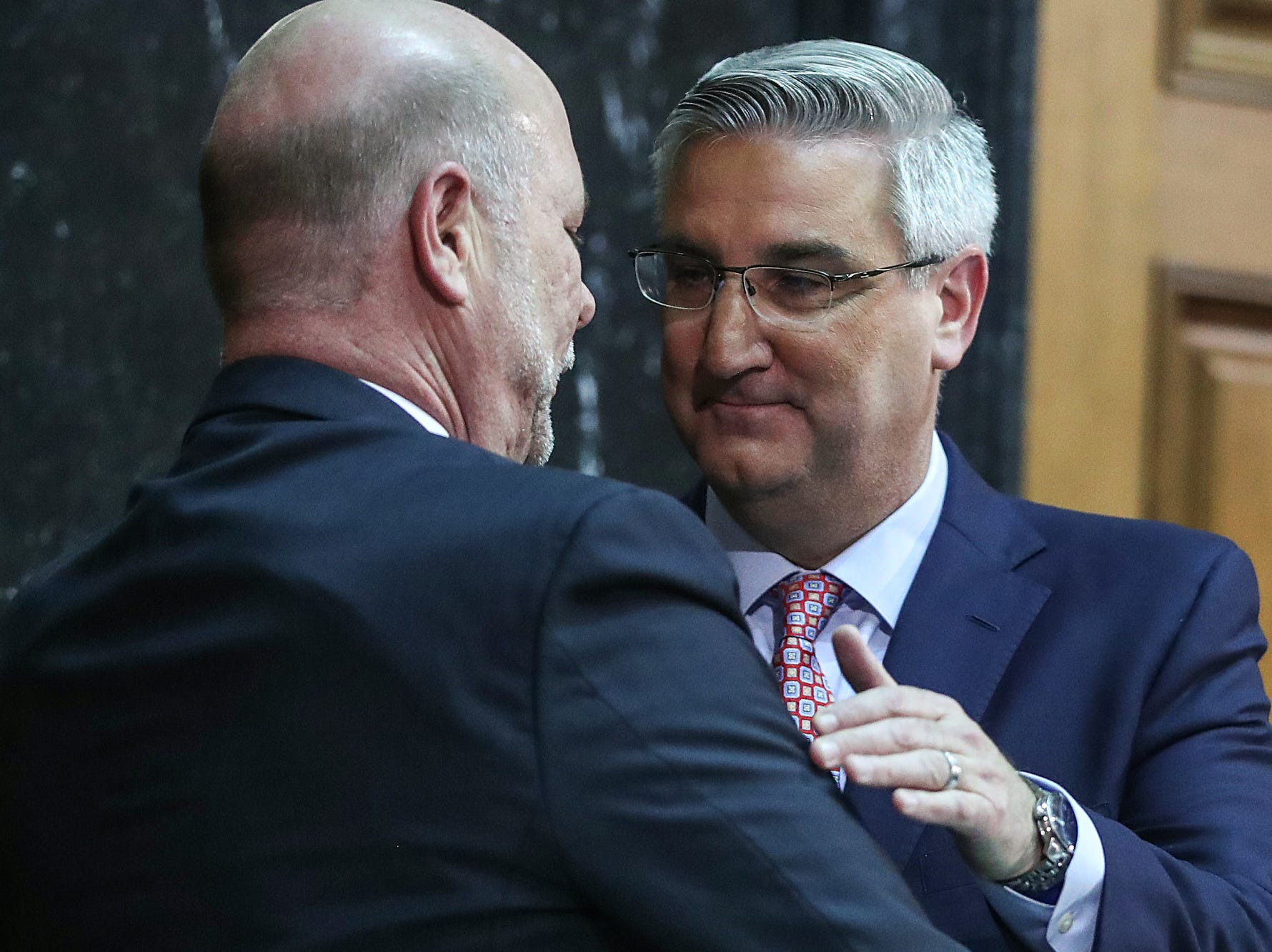 Gov. Eric Holcomb greets Speaker of the House Brian Bosma after delivering the annual State of the State address to the Indiana General Assembly at the Indiana Statehouse in Indianapolis, Tuesday, Jan. 15, 2019.