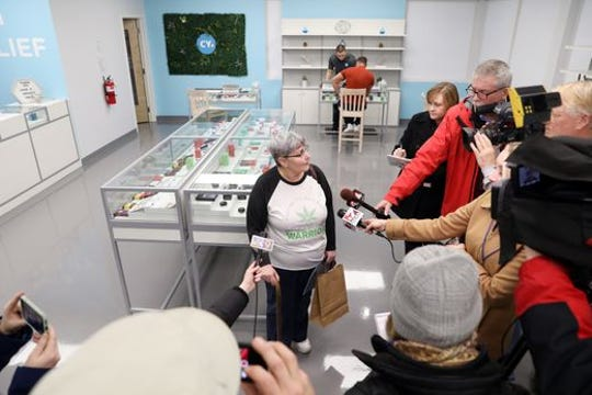 Joan Caleodis of Martins Ferry, Ohio, became the first person to purchase medical marijuana at CY+ Wintersville Dispensary on Wednesday, Jan. 16,2019.