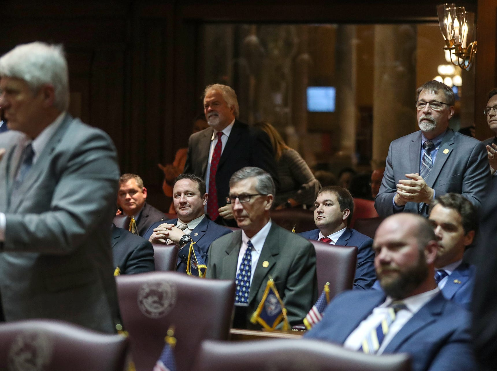 Members of the Indiana General assembly react to Gov. Eric Holcomb's remarks supporting bias crimes legislation, during his State of the State address at the Indiana Statehouse in Indianapolis, Tuesday, Jan. 15, 2019.