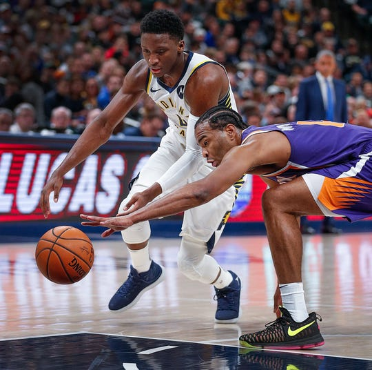 Indiana Pacers guard Victor Oladipo (4) and Phoenix Suns forward T.J. Warren (12) chase the ball in the first half of their game at Bankers Life Fieldhouse on Tuesday, Jan. 15, 2019.