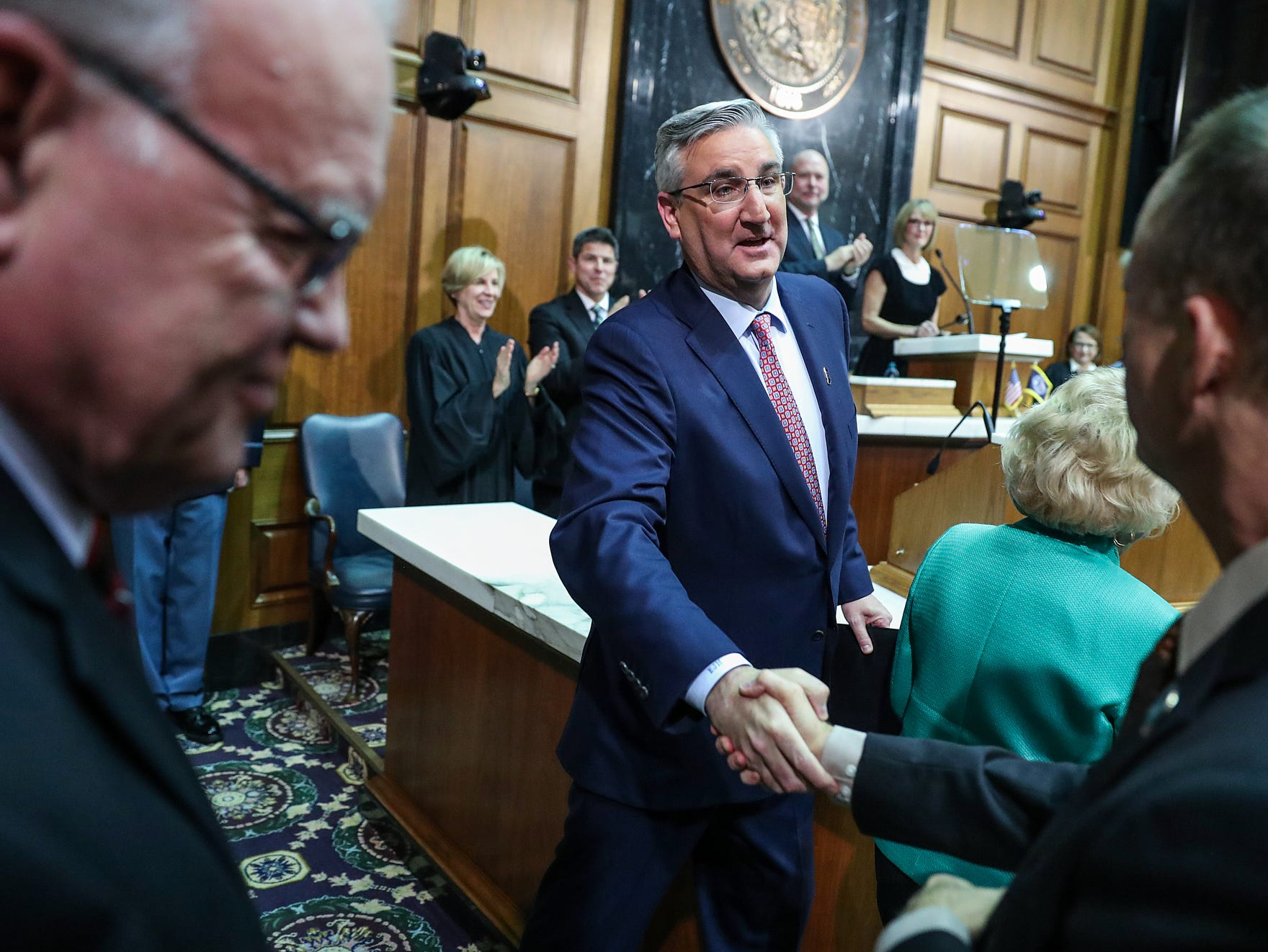 Gov. Eric Holcomb greets members of the crowd after delivering the annual State of the State address to the Indiana General Assembly at the Indiana Statehouse in Indianapolis, Tuesday, Jan. 15, 2019.