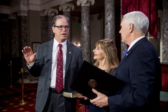 Vice President Mike Pence administers the Senate oath of office to Sen. Mike Braun, R-Ind., accompanied by his wife Maureen during a mock swearing in ceremony in the Old Senate Chamber on Capitol Hill in Washington, Thursday, Jan. 3, 2019, as the 116th Congress begins. (AP Photo/Andrew Harnik)