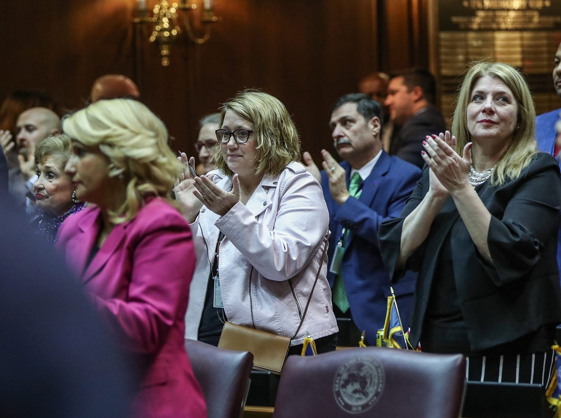 Members of the Indiana General Assembly react to Gov. Eric Holcomb's sentiment that teacher salaries should increase, during the annual State of the State address at the Indiana Statehouse in Indianapolis, Tuesday, Jan. 15, 2019.
