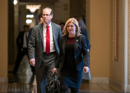 Newly-elected senators Mike Braun, left, a Republican from Indiana, and Rep. Marsha Blackburn, R-Tenn., leave a meeting in the office of Senate Majority Leader Mitch McConnell, R-Ky., at the Capitol in Washington, Tuesday, Nov. 13, 2018. Braun, a businessman, defeated incumbent Senator Joe Donnelly, D-Ind., and Blackburn replaces retiring Sen. Bob Corker, R-Tenn. (AP Photo/J. Scott Applewhite)