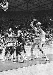 Carl Nicks, No. 22, watches teammate Larry Bird's shot fall through the basket during the 1979 NCAA tournament Final Four.