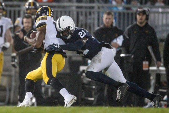 Penn State Nittany Lions cornerback Amani Oruwariye (21) attempts to tackle Iowa Hawkeyes wide receiver Brandon Smith (12)