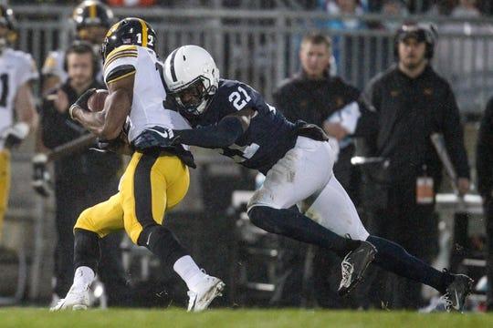 Penn State Nittany Lions cornerback Amani Oruwariye (21) attempts to tackle Iowa Hawkeyes wide receiver Brandon Smith (12)