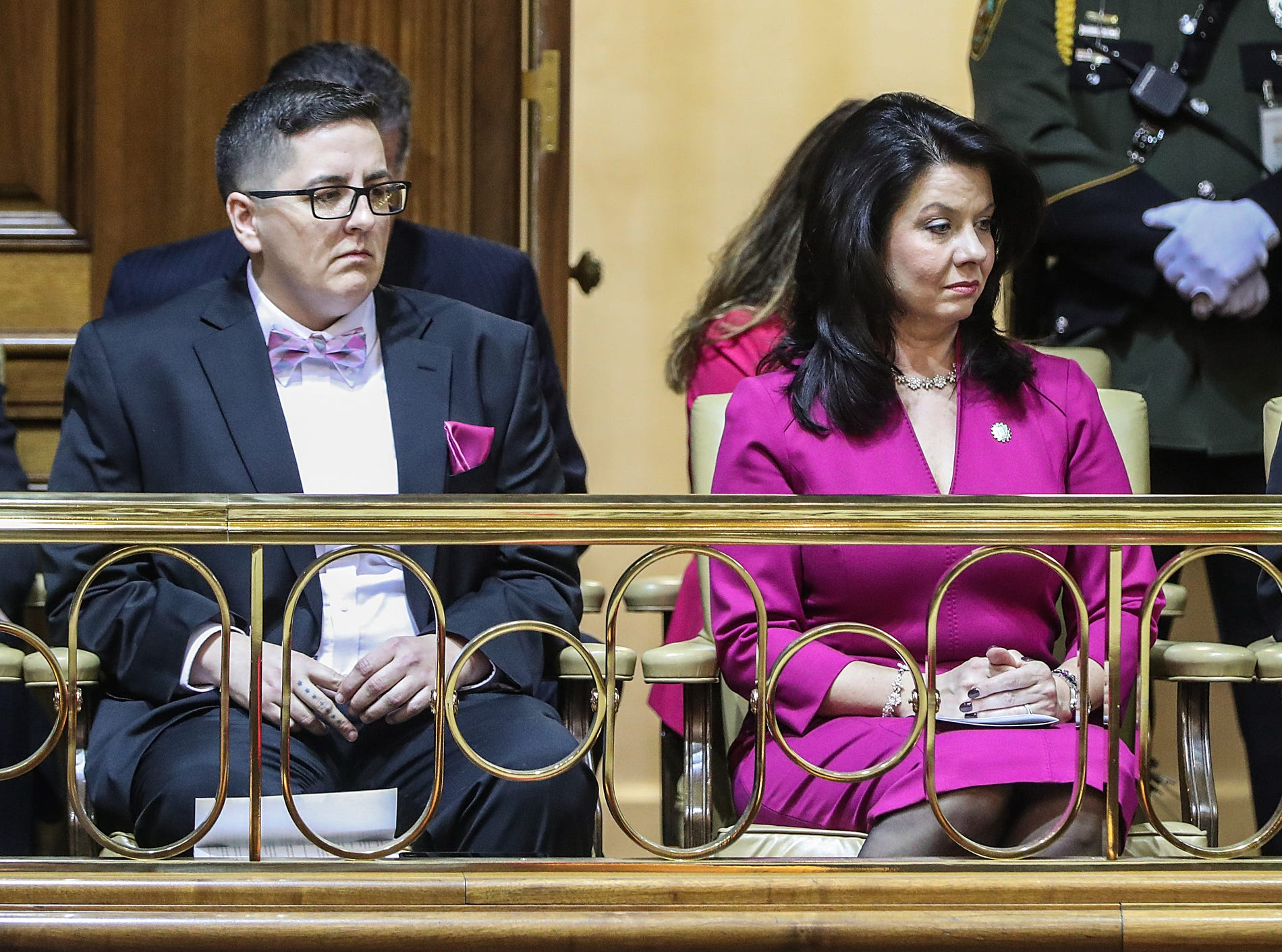 From left, Brittany Young and Janet Holcomb listen as Gov. Eric Holcomb delivers the annual State of the State address at the Indiana Statehouse in Indianapolis, Tuesday, Jan. 15, 2019. Young spent five years in prison where she learned welding and manufacturing. Since leaving Madison Correctional Facility, she's gotten a job and purchased her own home.