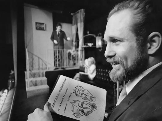 """Randy Galvin, owner-operator of the Black Curtain Dinner Theater holds a copy of his original script, """"The Immaculate Misconception,"""" at the theater in 1970."""