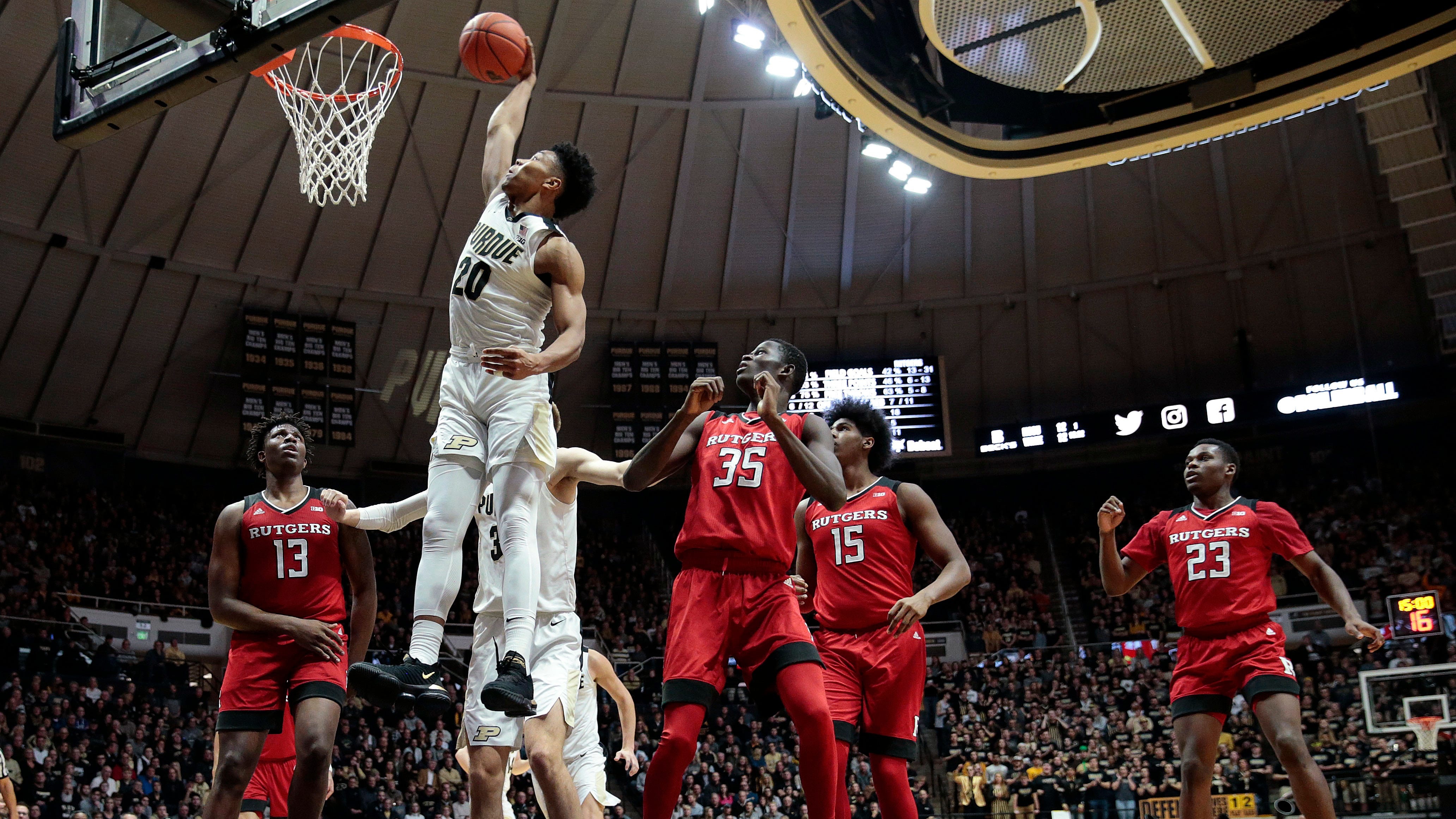 Purdue guard Nojel Eastern (20) dunks between Rutgers defenders Shaq Carter (13) and Issa Thiam (35) during the second half of an NCAA college basketball game in West Lafayette, Ind., Tuesday, Jan. 15, 2019. Purdue won 89-54.