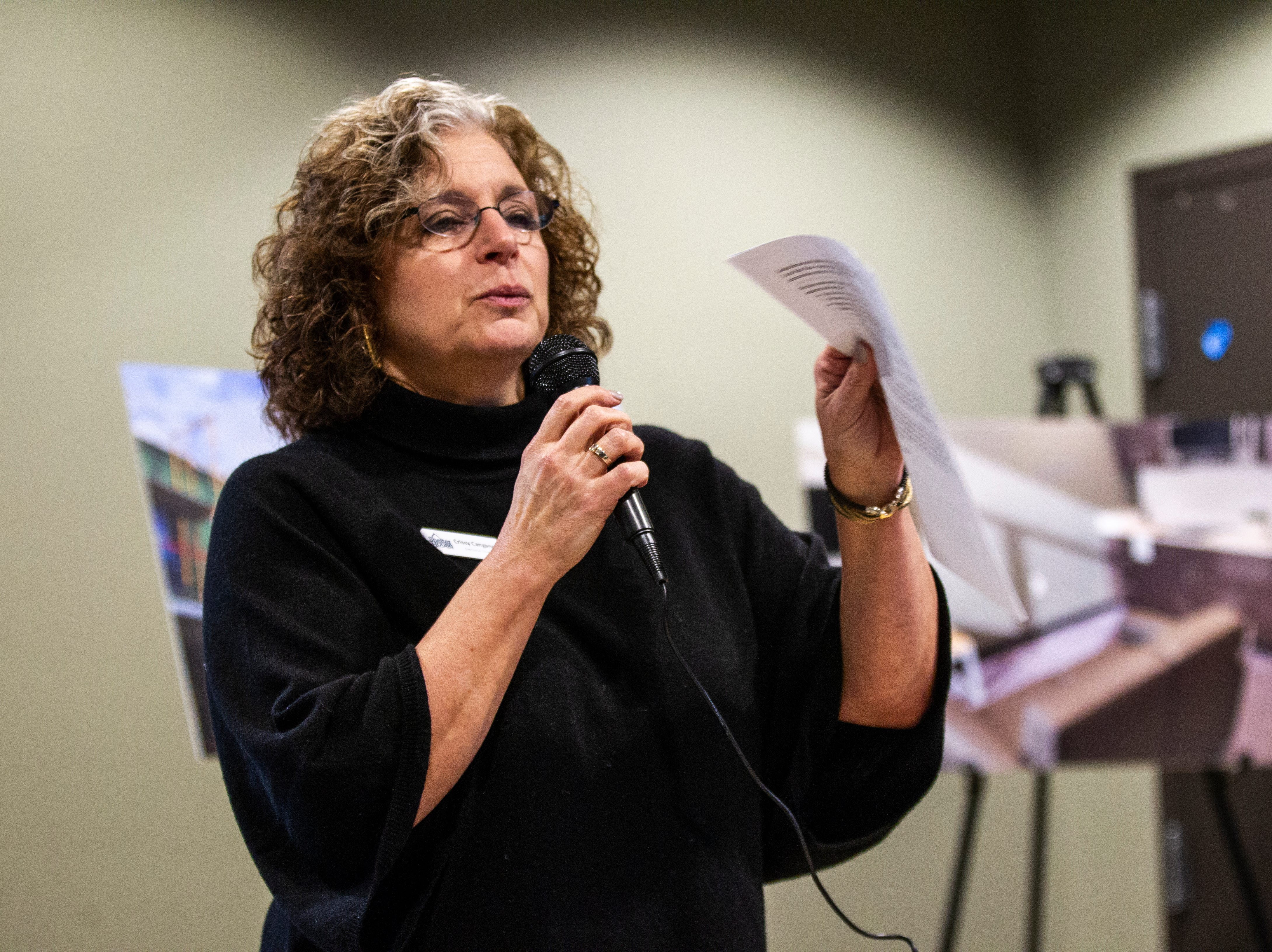 Shelter House Executive Director Crissy Canganelli speaks to community members during a tour of the newly completed homeless housing apartment complex on Wednesday, Jan. 16, 2019, at Cross Park Place in Iowa City, Iowa.