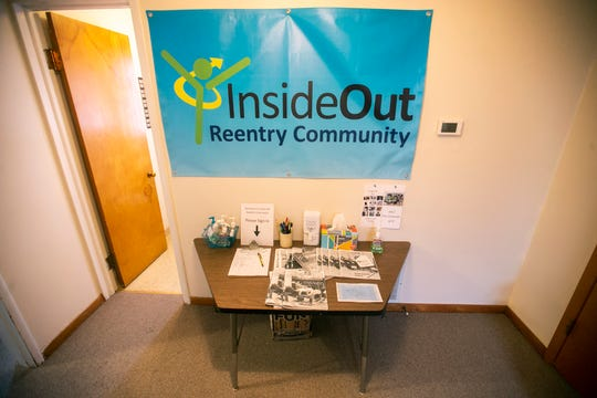 A banner hangs in an entryway on Wednesday, Jan. 16, 2019, at the Inside Out Reentry Community building in Iowa City, Iowa.