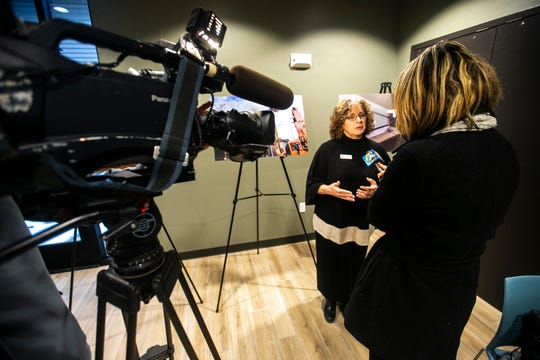 Shelter House Executive Director Crissy Canganelli speaks to a reporter during a tour of the newly completed homeless housing apartment complex on Wednesday, Jan. 16, 2019, at Cross Park Place in Iowa City, Iowa.